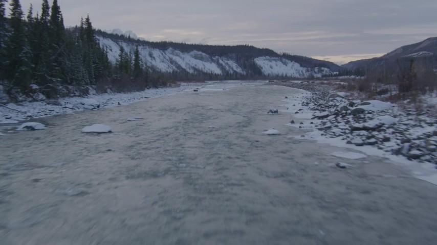 4K stock footage aerial video flying along Matanuska River in the snowy Matanuska River Valley, Alaska Aerial Stock Footage | AK0001_1076