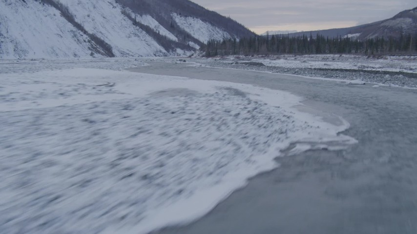 4K stock footage aerial video flying along the Matanuska River in snow covered valley, Alaska Aerial Stock Footage   AK0001_1081