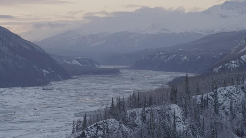 4K stock footage aerial video snowy Talkeetna Mountains beside snowy Matanuska River Valley, Alaska Aerial Stock Footage | AK0001_1093