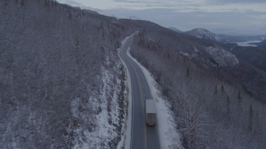 4K stock footage aerial video following a truck on Glenn Highway, near Sutton, in snow, at twilight, Alaska Aerial Stock Footage | AK0001_1103