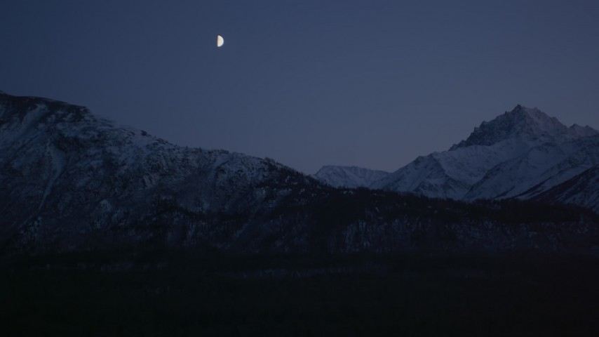 4K stock footage aerial video the moon over the snow covered Chugach Mountains at night, Alaska Aerial Stock Footage | AK0001_1107