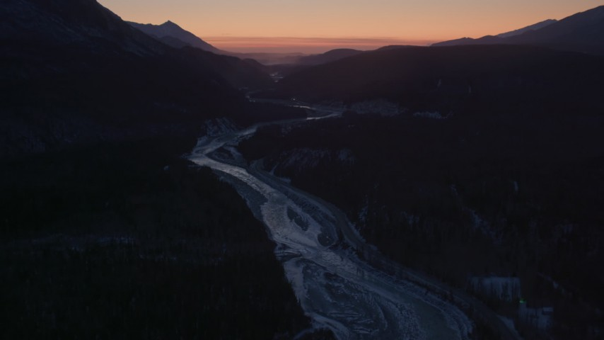 4K aerial stock footage video flying over the snow covered Matanuska River Valley at sunset, Alaska Aerial Stock Footage | AK0001_1110