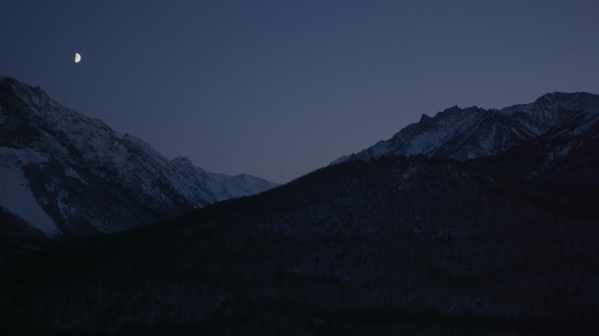 4K stock footage aerial video the moon over the snow covered Chugach Mountains at night, Alaska Aerial Stock Footage   AK0001_1111