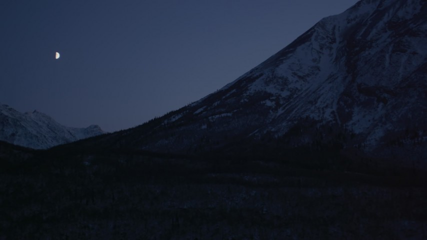 4K stock footage aerial video the moon over the snow covered Chugach Mountains at night, Alaska Aerial Stock Footage AK0001_1112 | Axiom Images