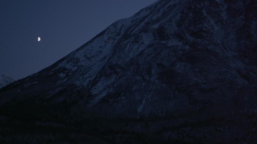 4K stock footage aerial video the moon over the snow covered Chugach Mountains at night, Alaska Aerial Stock Footage | AK0001_1113