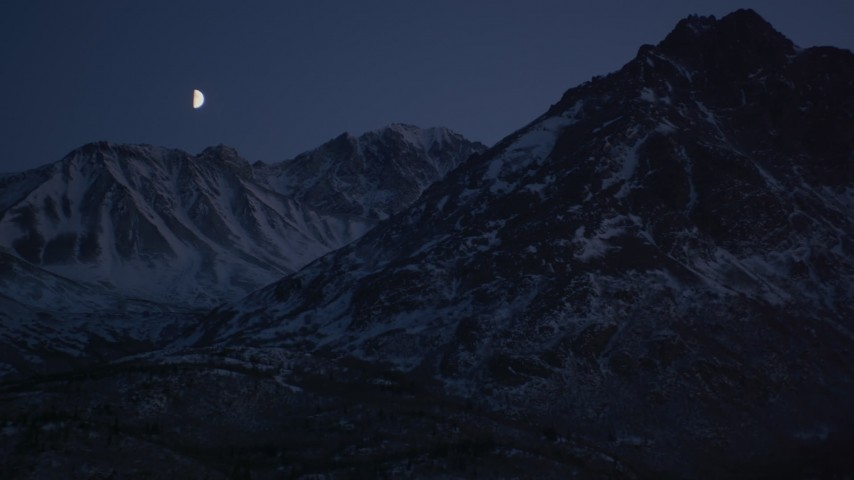 4K stock footage aerial video the moon over the snow covered Chugach Mountains at night, Alaska Aerial Stock Footage | AK0001_1119
