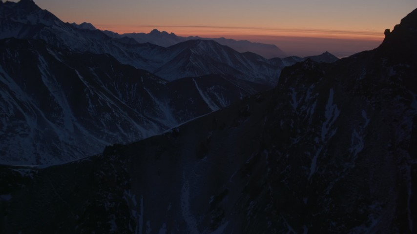 4K stock footage aerial video flying over snow covered ranges in the Chugach Mountains at twilight, Alaska Aerial Stock Footage | AK0001_1129