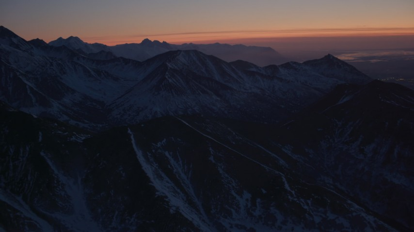 4K stock footage aerial video flying toward snow covered ranges in the Chugach Mountains at twilight, Alaska Aerial Stock Footage | AK0001_1130
