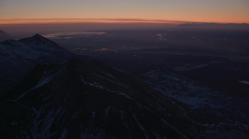 4K stock footage aerial video Anchorage seen from the snow covered Chugach Mountains at twilight, Alaska Aerial Stock Footage | AK0001_1131