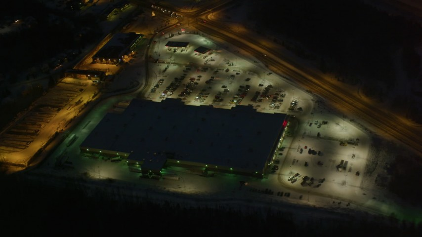 4K stock footage aerial video shopping center by Glenn Highway/Highway 1, Eagle River, Alaska, night Aerial Stock Footage | AK0001_1144