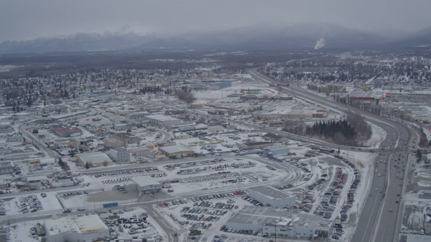 4K stock footage aerial video following Glenn Highway through snow covered Anchorage, Alaska Aerial Stock Footage | AK0001_1148