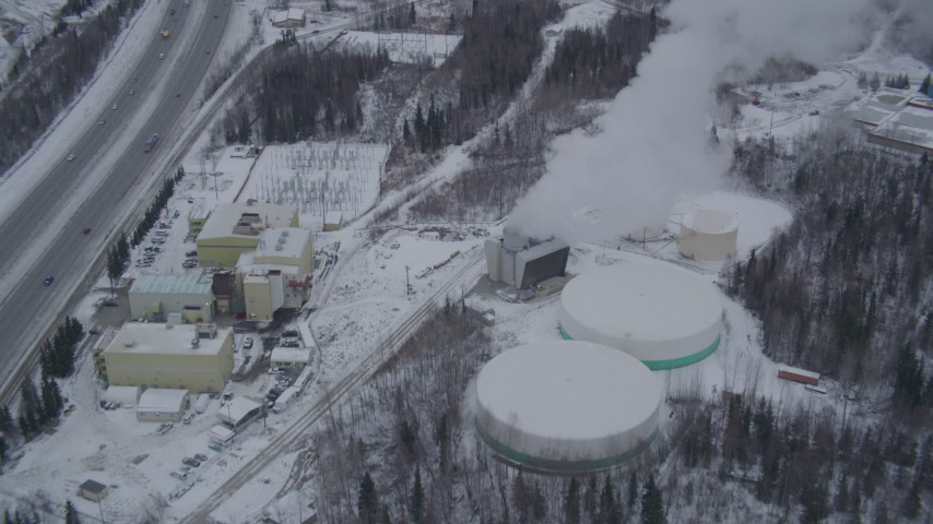4K stock footage aerial video tilting down on a snow covered power plant in Anchorage, Alaska Aerial Stock Footage | AK0001_1152