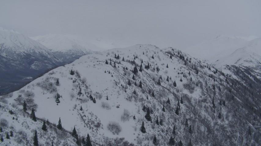 4K stock footage aerial video flying toward a snowy range in the Chugach Mountains, Alaska Aerial Stock Footage   AK0001_1180