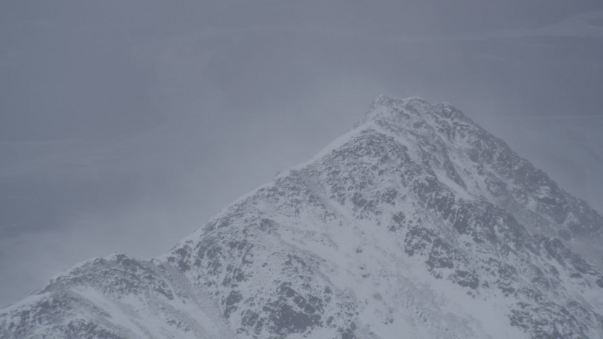 4K stock footage aerial video wind blowing snow off mountain peak, Chugach Mountains, Alaska Aerial Stock Footage | AK0001_1209