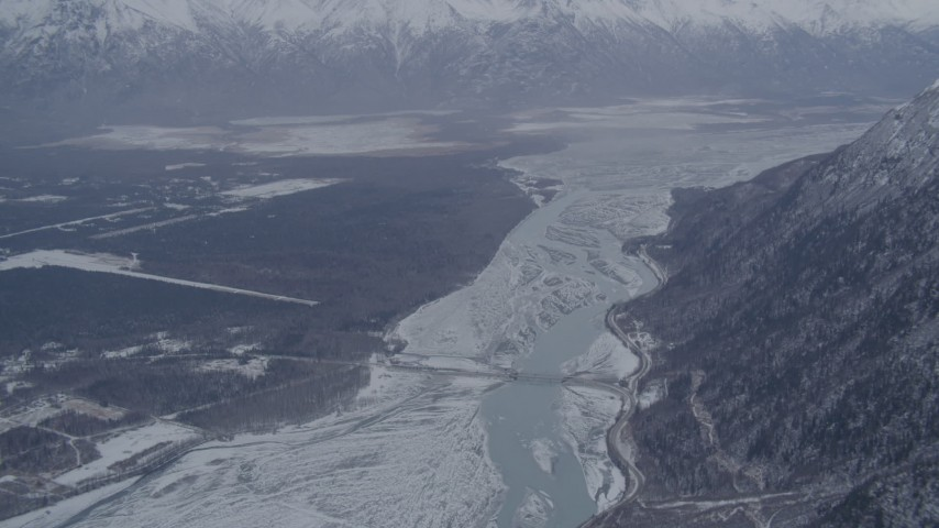 4K stock footage aerial video Old Glenn Highway bridge, snowy Knik River Valley near Butte, Alaska Aerial Stock Footage | AK0001_1212