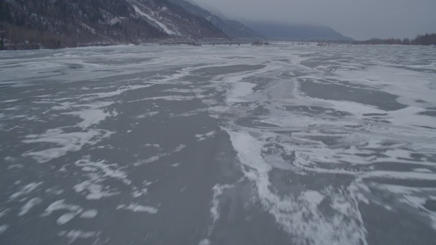 4K stock footage aerial video flying over frozen ground and iced over rivers, Butte, Alaska Aerial Stock Footage | AK0001_1276