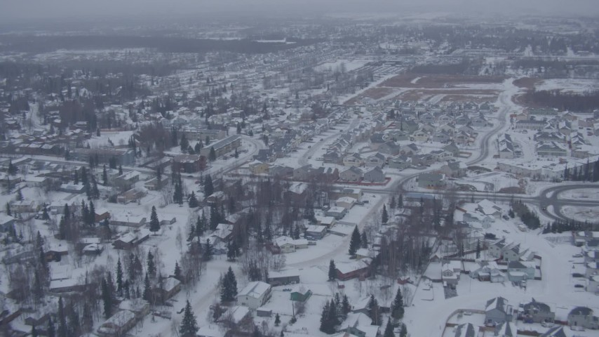 4K stock footage aerial video flying over snowy neighborhoods and apartment buildings, Anchorage, Alaska Aerial Stock Footage | AK0001_1323