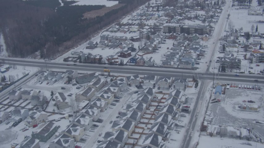 4K stock footage aerial video flying over snow covered neighborhoods and roads in Anchorage, Alaska Aerial Stock Footage | AK0001_1324