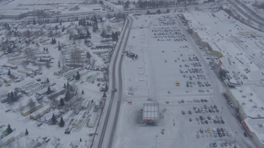 4K stock footage aerial video follow Penland Parkway to reveal snowy Merrill Field, Anchorage, Alaska Aerial Stock Footage | AK0001_1325