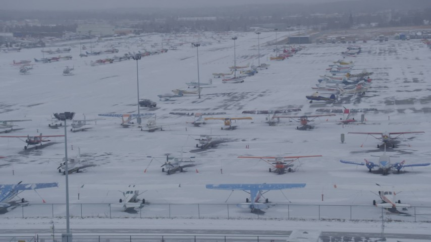 4K stock footage aerial video airplanes parked on snowy runway at Merrill Field, Anchorage, Alaska Aerial Stock Footage | AK0001_1326