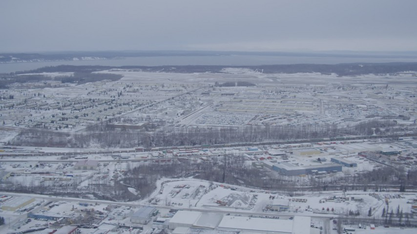 4K stock footage aerial video flying past snow covered Elmendorf Air Force Base, Anchorage, Alaska Aerial Stock Footage | AK0001_1330