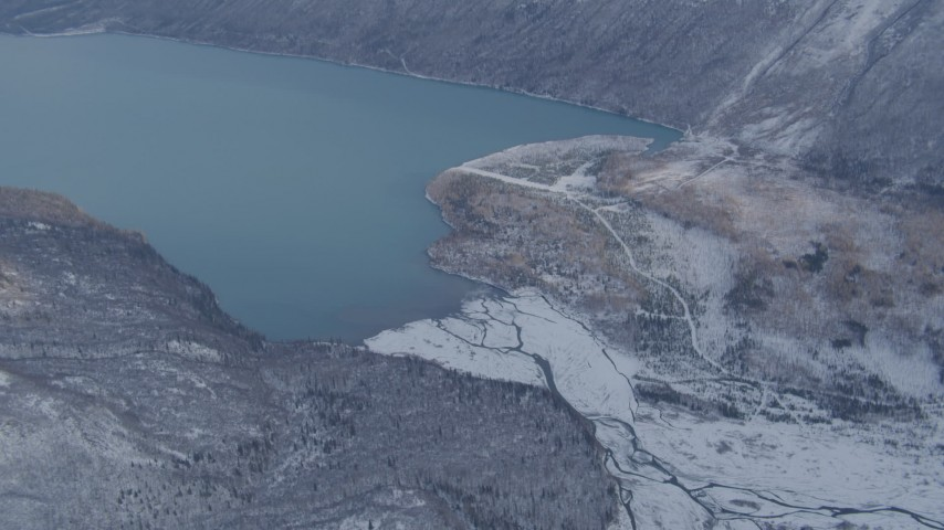 4K stock footage aerial video Eklutna Lake surrounded by snow covered ground, Alaska Aerial Stock Footage | AK0001_1354