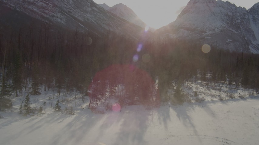 4K stock footage aerial video the forest and Chugach Mountains while lifting off snow covered ground, Alaska Aerial Stock Footage | AK0001_1359