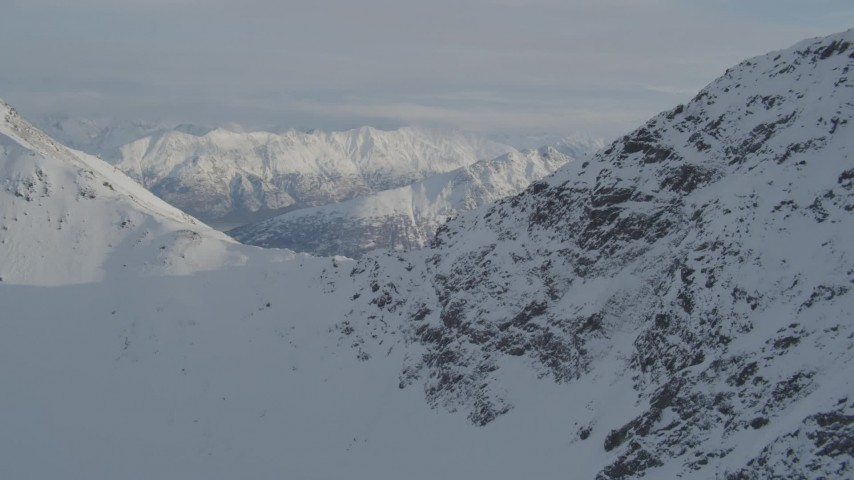4K stock footage aerial video flying over snowy mountain ridge in the Chugach Mountains, Alaska Aerial Stock Footage   AK0001_1369