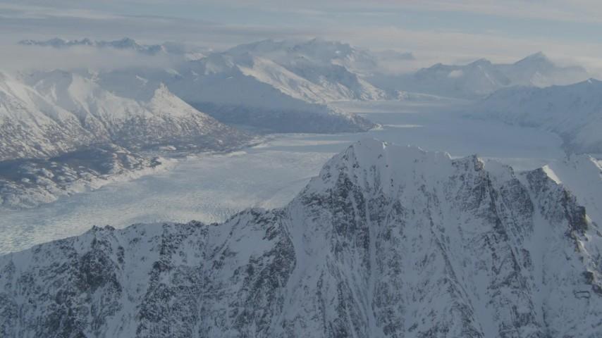 4K stock footage aerial video flying toward snowy ridge, Knik Glacier, Chugach Mountains, Alaska Aerial Stock Footage | AK0001_1375