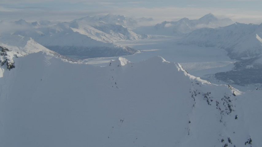 4K stock footage aerial video flying over snowy ridge toward the Knik Glacier, Alaska Aerial Stock Footage AK0001_1377 | Axiom Images