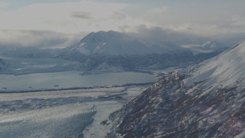 4K stock footage aerial video Inner Lake George between Knik Glacier and Chugach Mountains in snow, Alaska Aerial Stock Footage | AK0001_1383