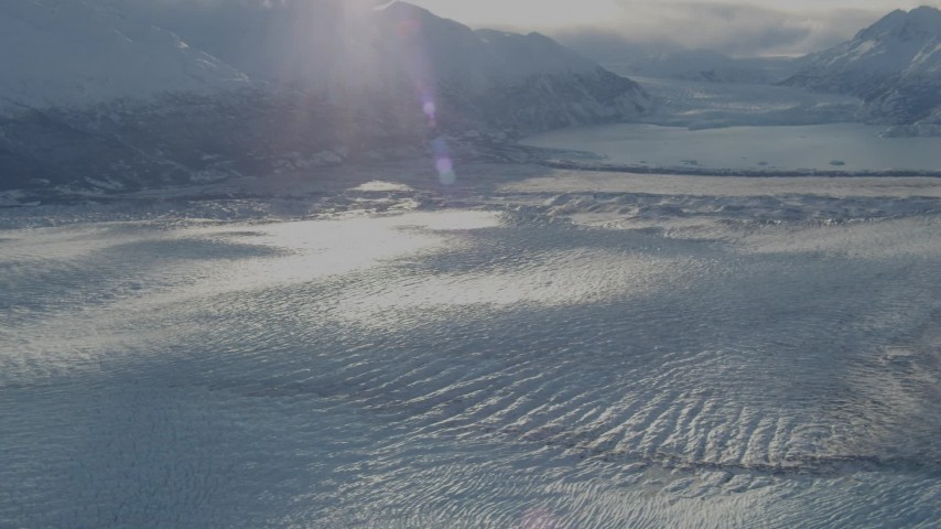 4K aerial video pan camera left along Knik Glacier to Chugach Mountains in snow, Alaska Aerial Stock Footage | AK0001_1384