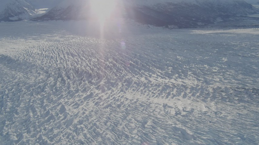 4K aerial video the surface of the snow covered Knik Glacier, Alaska Aerial Stock Footage | AK0001_1386