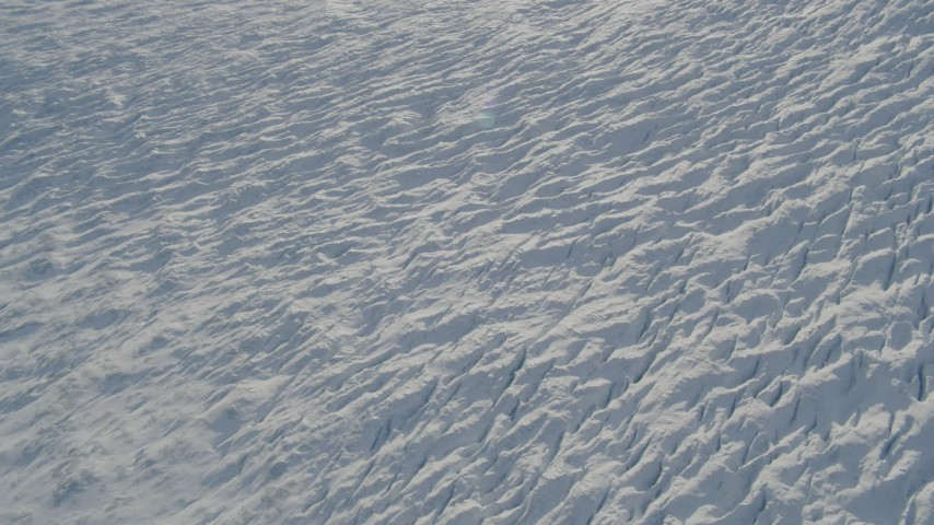 4K aerial video the surface of the snow covered Knik Glacier, Alaska Aerial Stock Footage | AK0001_1387