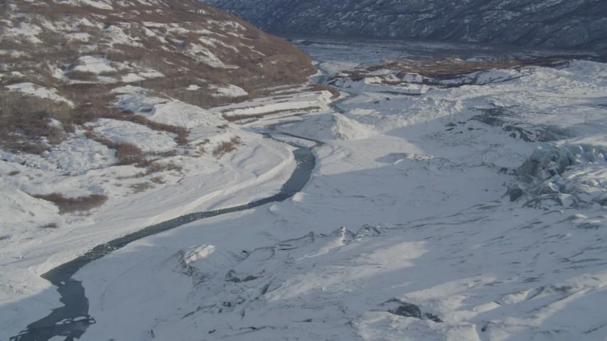4K stock footage aerial video a river near edge of the snow covered Knik Glacier, Alaska Aerial Stock Footage | AK0001_1391