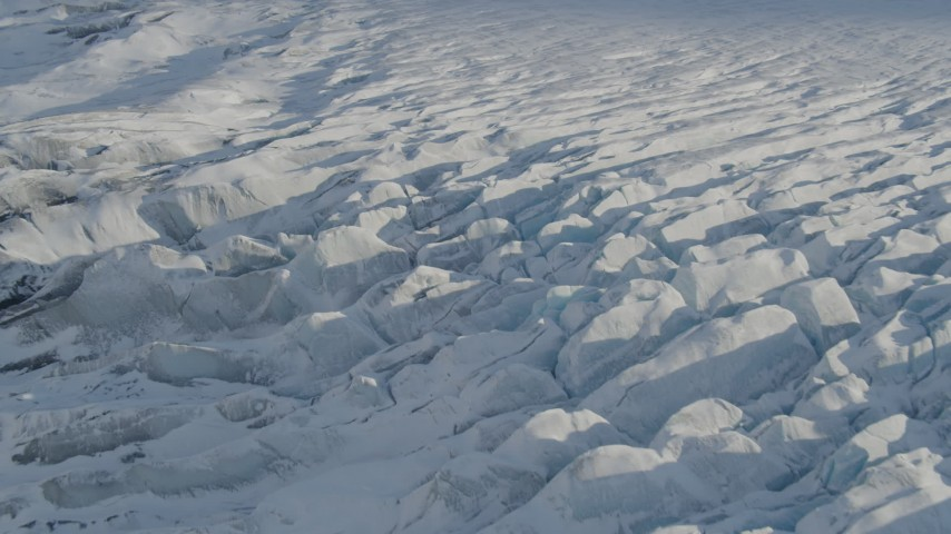4K stock footage aerial video tilting down on surface of snow covered Knik Glacier, Alaska Aerial Stock Footage | AK0001_1396