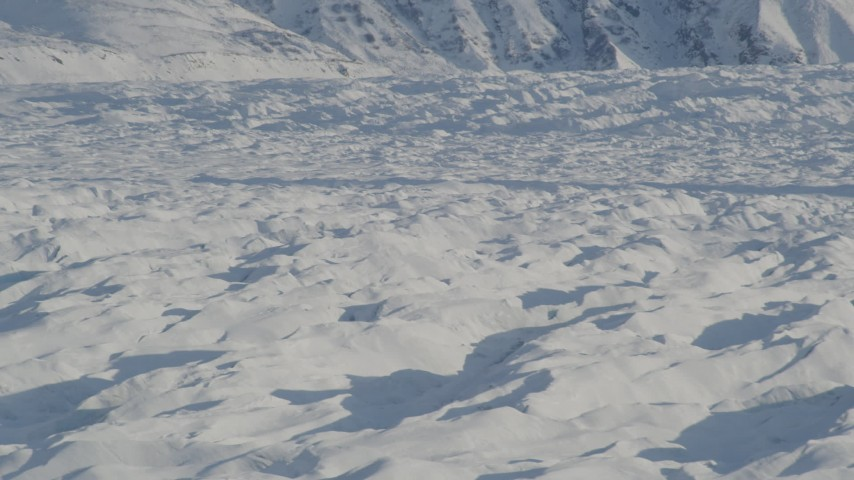 4K stock footage aerial video the surface of the snow covered Knik Glacier, Alaska Aerial Stock Footage | AK0001_1397