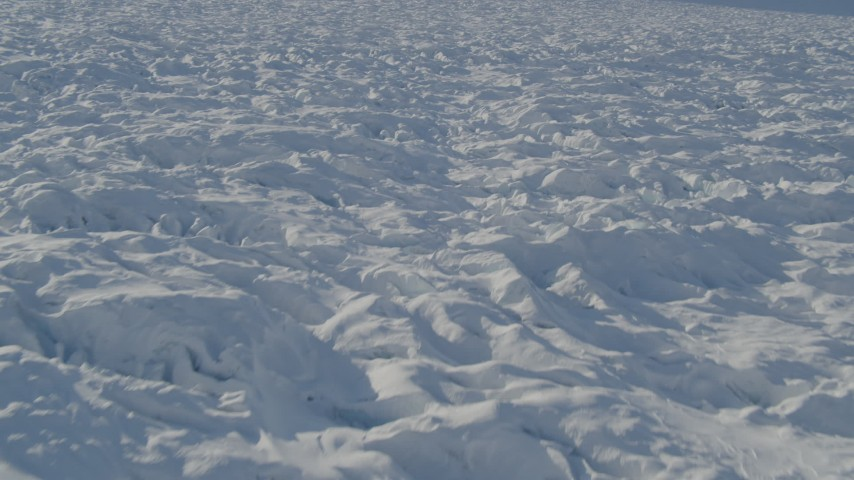4K stock footage aerial video flying over surface of the snow covered Knik Glacier, Alaska Aerial Stock Footage | AK0001_1402