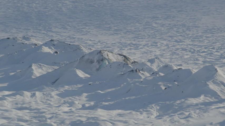 4K stock footage aerial video the snow covered raised ridge along Knik Glacier, Alaska Aerial Stock Footage | AK0001_1403