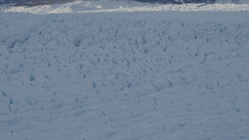 4K stock footage aerial video the shadowed, snow covered surface of the Knik Glacier, Alaska Aerial Stock Footage | AK0001_1408