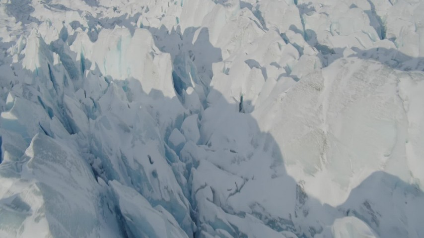 4K aerial video the jagged, snow covered surface of the Knik Glacier, Alaska Aerial Stock Footage | AK0001_1417