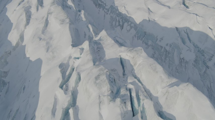 4K stock footage aerial video the ridged, snow covered surface of the Knik Glacier, Alaska Aerial Stock Footage | AK0001_1418