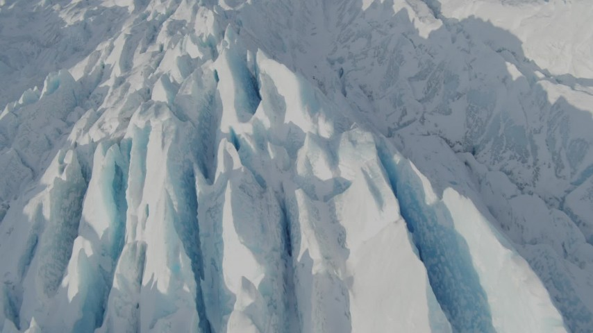 4K stock footage aerial video the jagged, snow covered surface of the Knik Glacier, Alaska Aerial Stock Footage | AK0001_1421