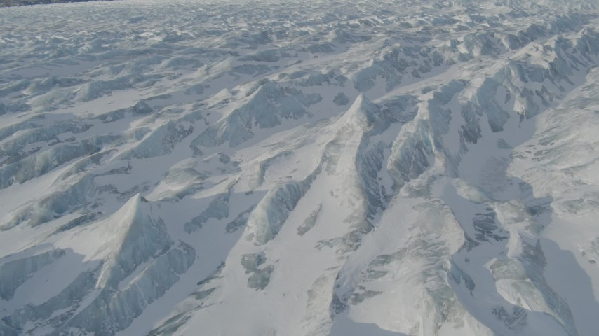 4K stock footage aerial video the ridged, snow covered surface of the Knik Glacier, Alaska Aerial Stock Footage | AK0001_1422