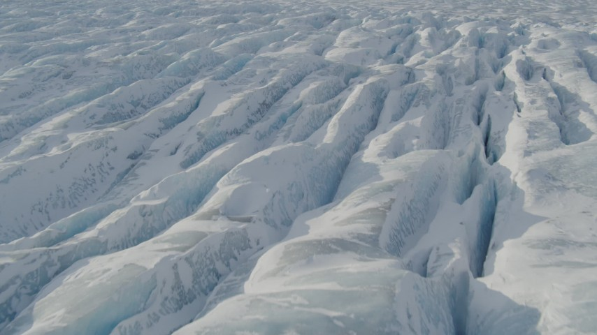 4K stock footage aerial video the ridged, snow covered surface of the Knik Glacier, Alaska Aerial Stock Footage | AK0001_1425