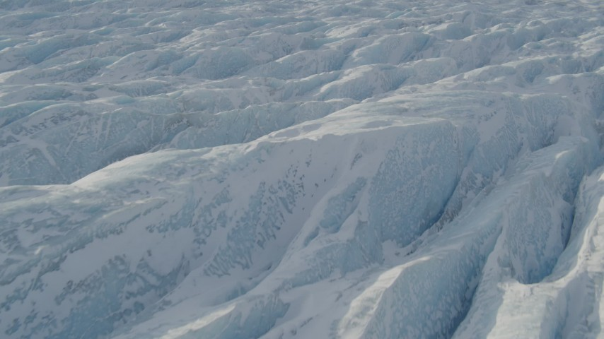 4K aerial video the jagged, snow covered surface of the Knik Glacier, Alaska Aerial Stock Footage | AK0001_1426