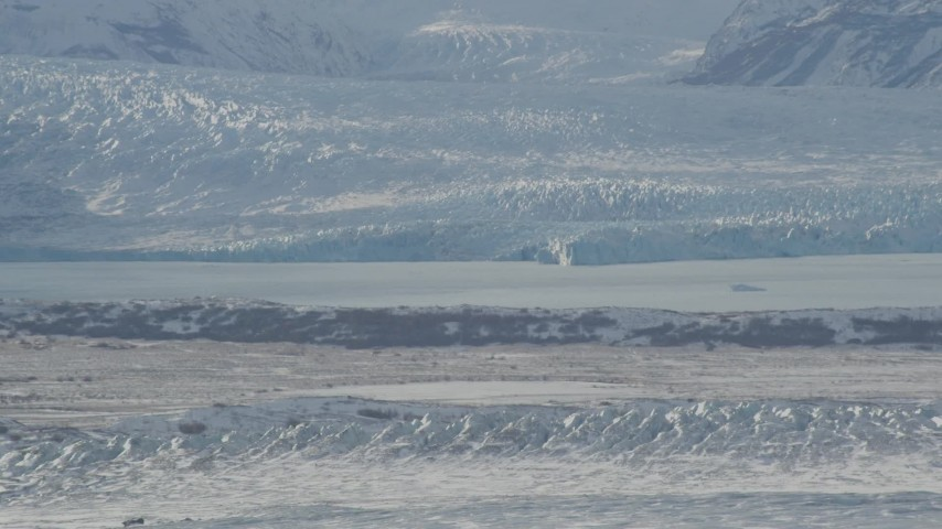 4K stock footage aerial video snow covered glacier spilling into Inner Lake George, from Knik Glacier, Alaska Aerial Stock Footage | AK0001_1429