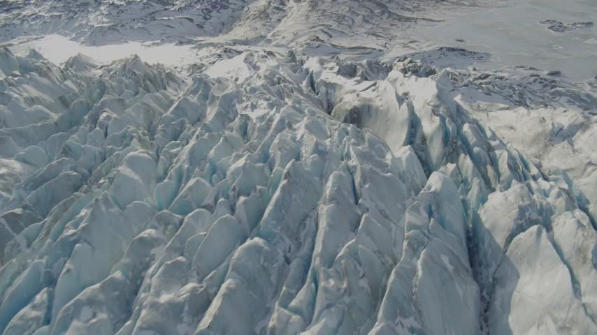 4K stock footage aerial video tilt down on jagged, snow covered surface of Knik Glacier, Alaska Aerial Stock Footage | AK0001_1431