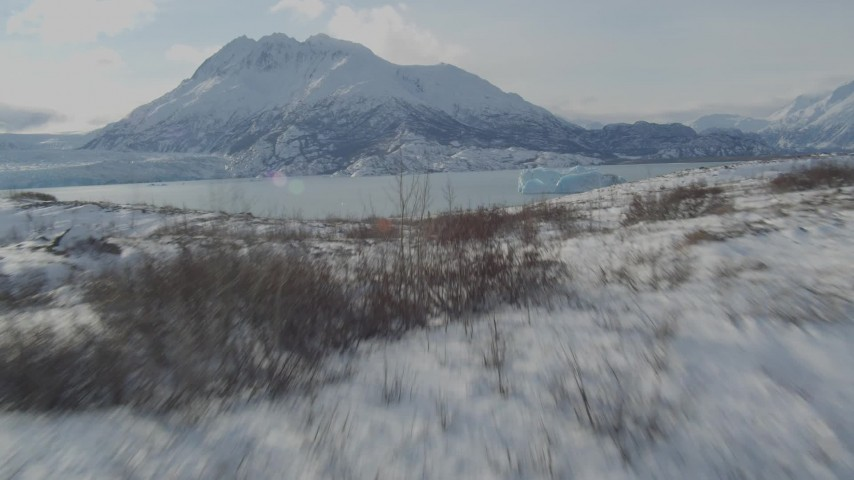 4K aerial stock footage video flying over the snow covered Knik Glacier revealing Inner Lake George, Alaska Aerial Stock Footage | AK0001_1432