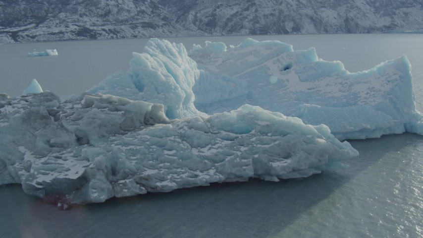 4K stock footage aerial video flying over a chunk of glacial ice on Inner Lake George, Alaska in snow Aerial Stock Footage | AK0001_1437